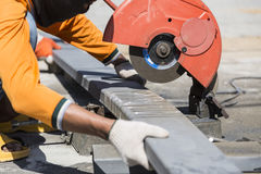 Worker cutting metal with unsafety position Stock Photos
