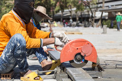 Worker cutting metal with unsafety position Royalty Free Stock Image