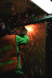 Worker cutting old steel pipe Stock Images