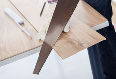 Worker Cutting Piece Of Laminate Royalty Free Stock Image