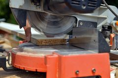 Worker Cutting Plywood Using Circular Saw. Industrial Concept. royalty free stock photography