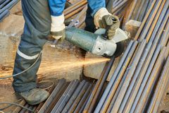 Worker cutting rebar by grinding machine Stock Photography