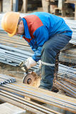 Worker cutting rebar by grinding machine Stock Image