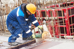 Worker cutting rebar by grinding machine Royalty Free Stock Photography