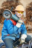 Worker cutting rebar by grinding machine Stock Photos