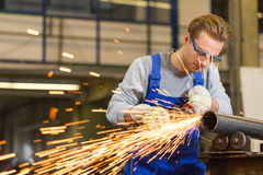 Worker cutting steel with angle grinder Royalty Free Stock Photo