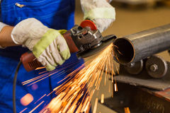 Worker cutting steel with angle grinder Royalty Free Stock Photos