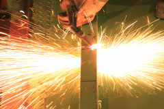 Worker cutting steel bar by using metal torch. Stock Image