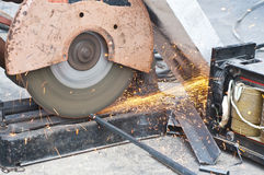 Worker cutting steel bars. Royalty Free Stock Photos