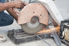Worker cutting steel bars. Stock Photo