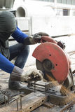 Worker cutting steel. Royalty Free Stock Photo