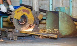 Worker cutting steel by cutting wheel Royalty Free Stock Image