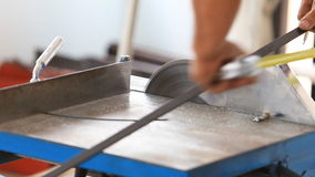 Worker cutting steel for house building stock footage