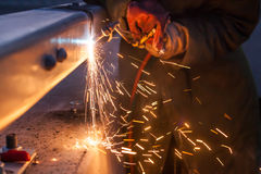 Worker cutting steel pipe using metal torch Stock Images