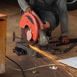 Worker cutting steel rod Stock Images