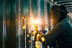 Worker cutting steel sheet by gas cutting Stock Photography