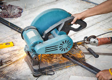 Worker cutting steel tube Royalty Free Stock Images
