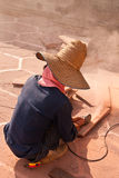 Worker cutting tile  Royalty Free Stock Photos