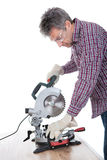 Worker cutting timber using circular saw Stock Photos