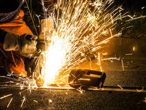 Worker cutting tracks Stock Photography
