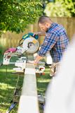 Worker Cutting Wood Using Table Saw At Site Royalty Free Stock Images