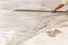 Worker decorative concrete slab Royalty Free Stock Images