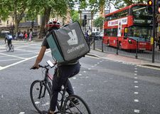 A worker from Deliveroo stock image