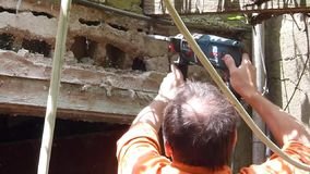 Worker demolishing wall. Worker demolishing a wall with a drill stock video footage