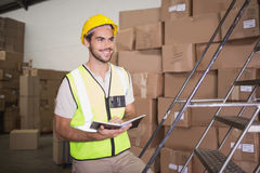 Worker with diary in warehouse. Manual worker with diary in the warehouse Royalty Free Stock Images
