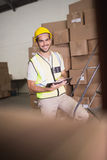 Worker with diary in warehouse Stock Photo