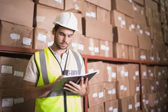 Worker with diary in warehouse. Manual worker with diary in the warehouse Stock Photos