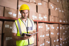 Worker with diary in warehouse. Manual worker with diary in the warehouse Royalty Free Stock Photos