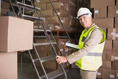 Worker with diary in warehouse. Portrait of worker with diary in the warehouse Stock Photos