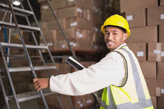 Worker with diary in warehouse. Portrait of worker with diary in the warehouse Stock Image
