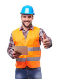 Worker with digital tablet makes a gesture thumb up Royalty Free Stock Photography