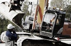 Worker directing large bulldozer Stock Image