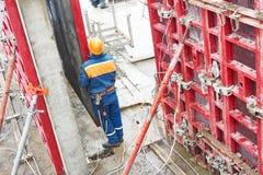 Worker disassemble falsework construction Stock Photos