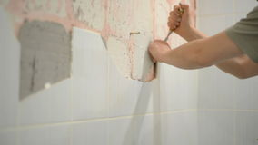 The worker dismantles the ceramic tile stock footage