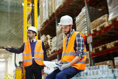 Worker with document. Warehouse manager reading paper in working environment stock photo