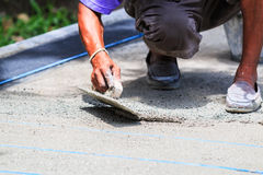 Worker does smooth the plasterer concrete Stock Images