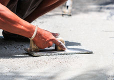 Worker does smooth the plasterer concrete. With a trowel Stock Photo