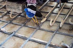 Worker doing steelwork for reinforcement of concrete floor at the construction site stock photos