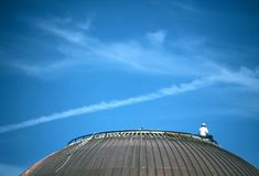 Worker on Dome Roof. Worker on a copper dome roof Stock Photos