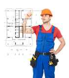 Worker drawing the scheme of a new house Royalty Free Stock Photos