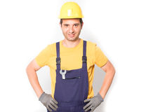 Worker dressed in overalls  isolated on white Royalty Free Stock Images