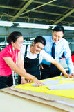 Worker, Dressmaker and CEO in a factory Royalty Free Stock Photos