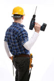 Worker with a drill Stock Images