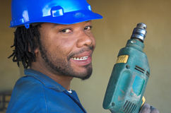 Worker and drill. Smiling construction worker with power tool drill Stock Image