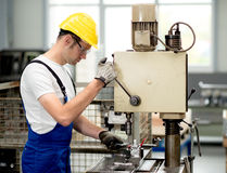 Worker on drill machine. Worker with safety glasses on drill machine stock photo