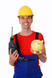 Worker with drill and piggy bank Royalty Free Stock Images